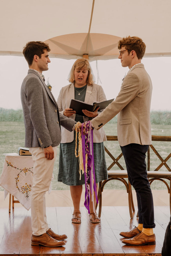 Cornish wedding celebrant conducting a hand fasting ceremony for a same sex couple