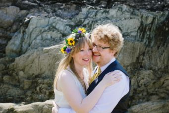 Bride and groom embracing at their wedding at Polhawn Fort - Wild And Free Photography, wedding photographer in Cornwall