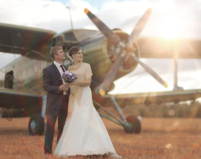 Wedding couple in love vintage aircraft