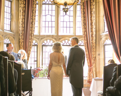 Highgate House great hall, couple standing in front of the windows getting married