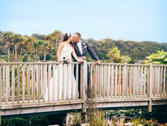 Bride and groom standing on the bridge at The Falmouth Hotel, perfect Cornwall wedding venue