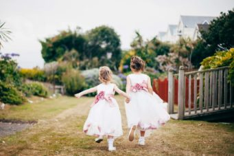 Cute flowergirls running in the gardens at The Falmouth Hotel, perfect Cornwall wedding venue