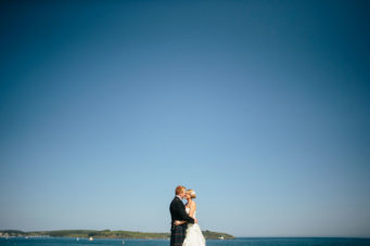 Bride and groom on the beach at The Falmouth Hotel, perfect Cornwall wedding venue