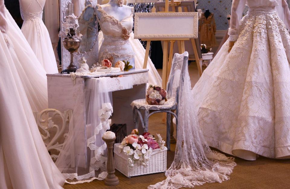 Wedding dresses and wedding decorations shown at a wedding fair