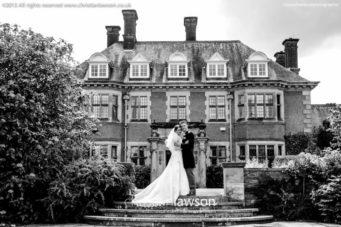 Bride and groom outside Dunchurch Park Hotel wedding venue Warwickshire