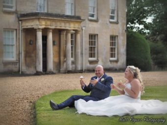 Couple sitting outside Cranford Hall, perfect wedding venue in Kettering, Northamptonshire