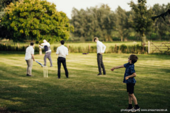 Wedding guests playing on the lawns at Cranford Hall, perfect wedding venue in Kettering, Northamptonshire