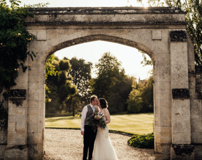 Bride and groom in the gardens at Cranford Hall, perfect wedding venue in Kettering, Northamptonshire