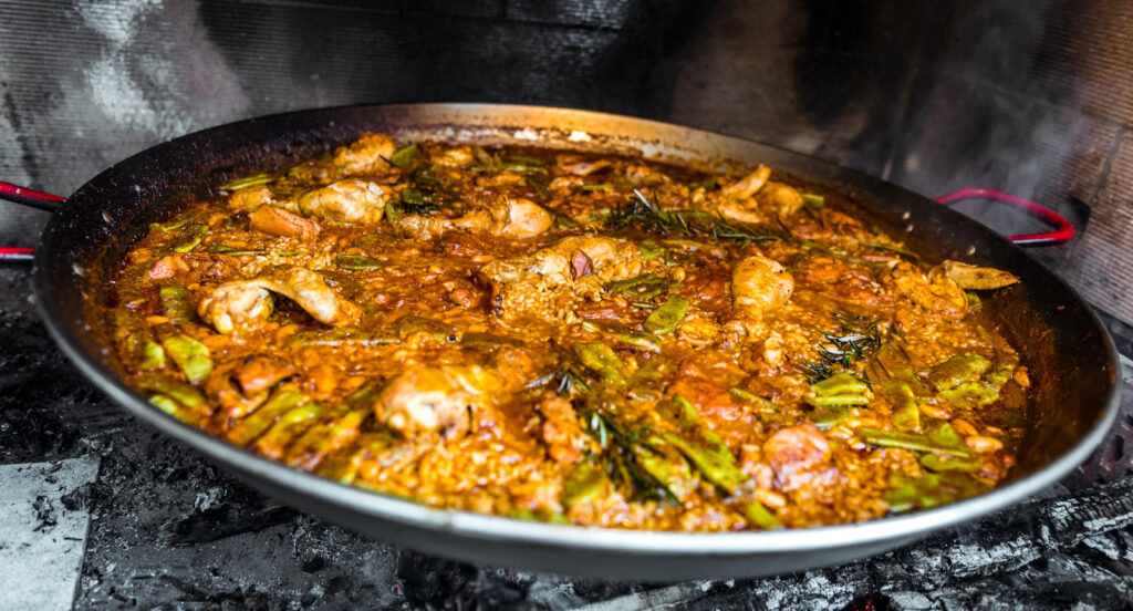 Alternative wedding catering - big pans of paella for your wedding catering