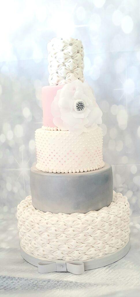Pretty white, pink and grey wedding cake