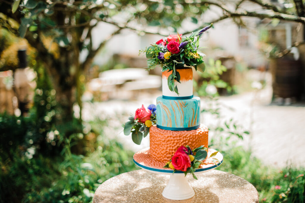 Bronze, turquoise and blue wedding cake for a photo shoot at Trenderway wedding venue in Cornwall